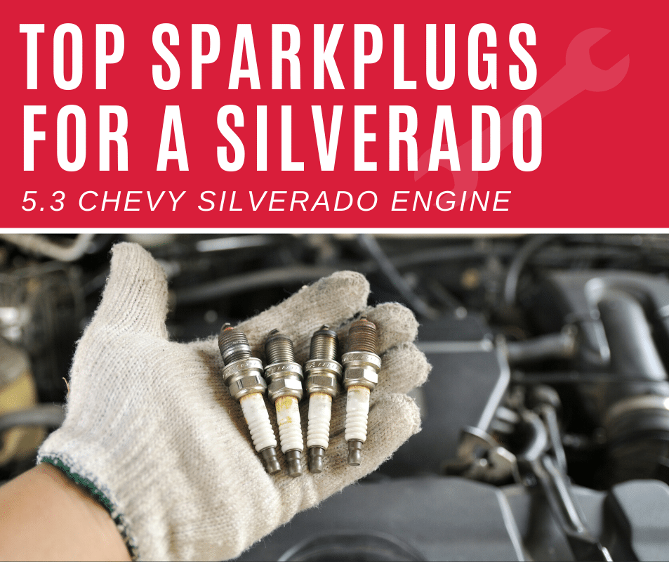 Man holding up sparkplugs for a Silverado 5.3 engine